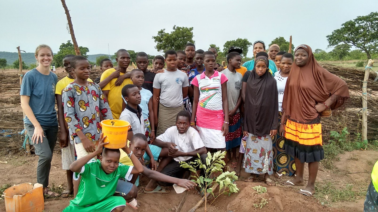 Hannah and community in field, Hannah Martin, Peace Corps Benin