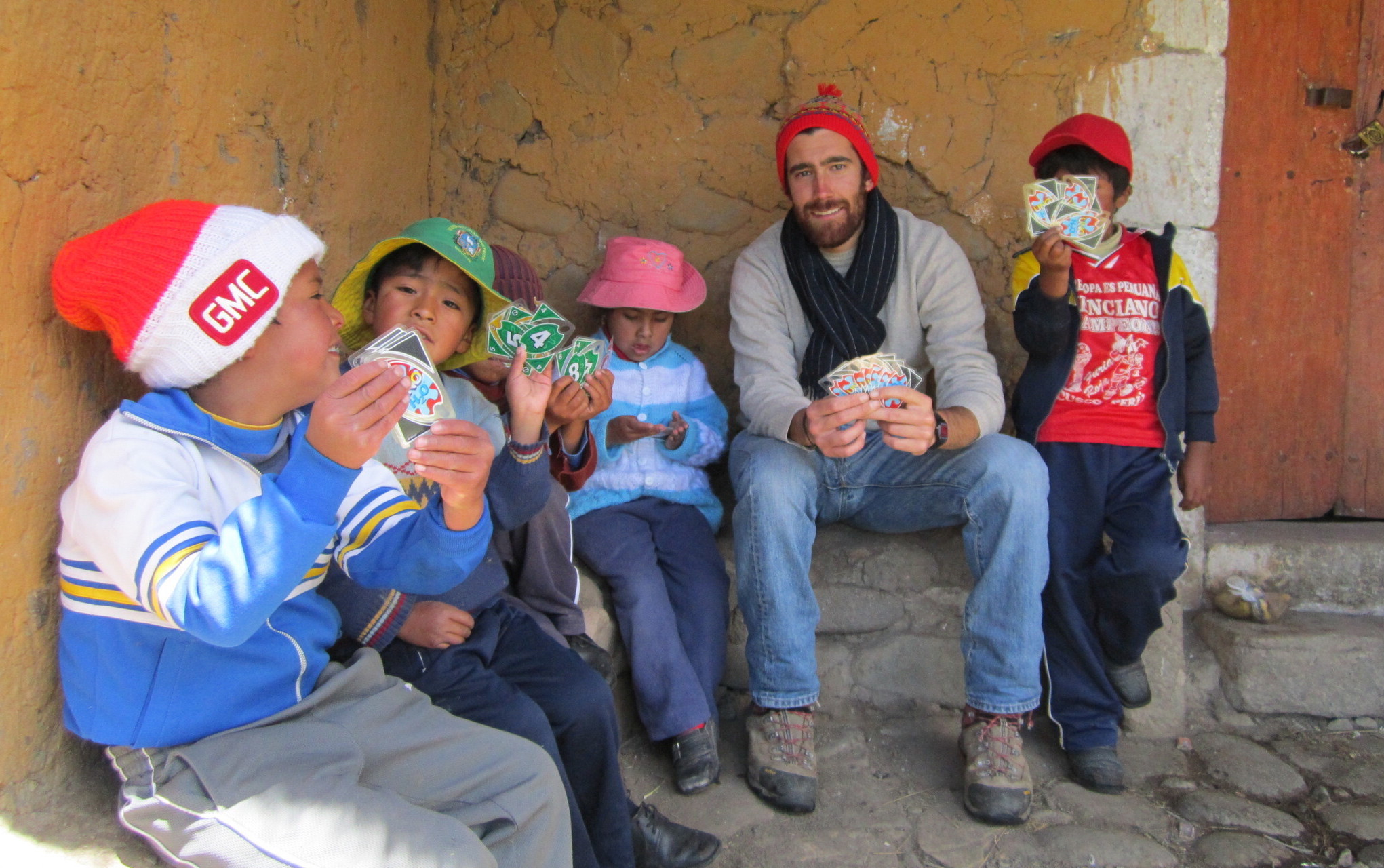 Mario playing cards with kids, Mario Nuño-Whelan, Peace Corps Peru